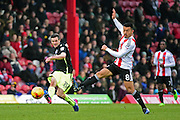 Brighton & Hove Albion winger Jamie Murphy (15) clears from Brentford midfielder Nico Yennaris (8) during the EFL Sky Bet Championship match between Brentford and Brighton and Hove Albion at Griffin Park, London, England on 5 February 2017. Photo by Jon Bromley.