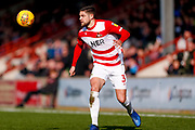 Doncaster Rovers defender Danny Andrew (3) with his eye on the ball during the EFL Sky Bet League 1 match between Scunthorpe United and Doncaster Rovers at Glanford Park, Scunthorpe, England on 23 February 2019.