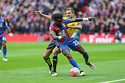 Crystal Palace's Pape N'Diaye Souaré and Watford's Almen Abdi battle for the ball during the The FA Cup match between Crystal Palace and Watford at Wembley Stadium, London, England on 24 April 2016. Photo by Shane Healey.
