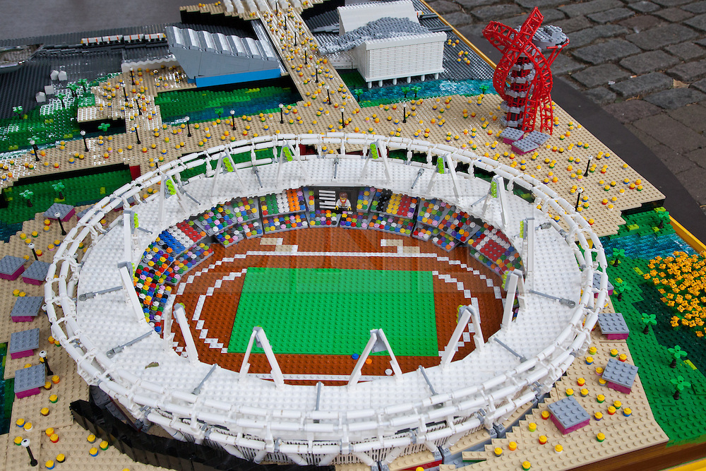 © Licensed to London News Pictures. 05/07/2012. London, UK. A minature LEGO replica of the Olympic stadium and Orbit. LEGO® creator, Warren Elsmore used around 250,000 standard LEGO® bricks to create a miniature replica of the London 2012 Olympic Games Park. The model took Warren, aged 35 from Edinburgh, 300 hours to construct and is on display at the 'Visit Denmark' Olympic Village  at St Katharine Docks, London. Photo credit : Vickie Flores/LNP