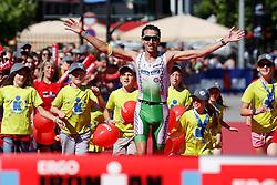 21.06.2014, Remich, LUX, Ergo Ironman 70.3, im Bild Marino Vanhoenacker (amptierender Triathlon Europameister, Belgium) feiert beim Zieleinlauf seinen Sieg // during the Ergo Ironman 70.3 in Remich, Luxembourg on 2014/06/21. EXPA Pictures &copy; 2014, PhotoCredit: EXPA/ Eibner-Pressefoto/ Schueler<br /> <br /> *****ATTENTION - OUT of GER*****