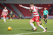Doncaster Rovers Midfielder Tommy Rowe (10) battles with Bristol Rovers Midfielder Stuart Sinclair during the EFL Sky Bet League 1 match between Doncaster Rovers and Bristol Rovers at the Keepmoat Stadium, Doncaster, England on 27 January 2018. Photo by Craig Zadoroznyj.