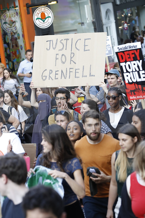 © Licensed to London News Pictures. 16/06/2017. London, UK. Protestors calling for justice for the victims of the Grenfell Tower fire disaster march from Kensington Town Hall. The blaze engulfed the 27-storey building. Police say 30 people have been killed with 34 still in hospital, 18 of whom are in critical condition. The fire brigade say that they don't expect to find anyone else alive. Photo credit: Peter Macdiarmid/LNP