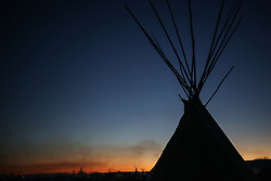 November 25, 2016 - Cannon Ball, North Dakota, U.S - A yurt is silhouetted as the sun rises at the Oceti Sakowin Camp at the Standing Rock Indian Reservation in Cannon Ball, North Dakota. (Credit Image: © Joel Angel Ju‡Rez via ZUMA Wire)