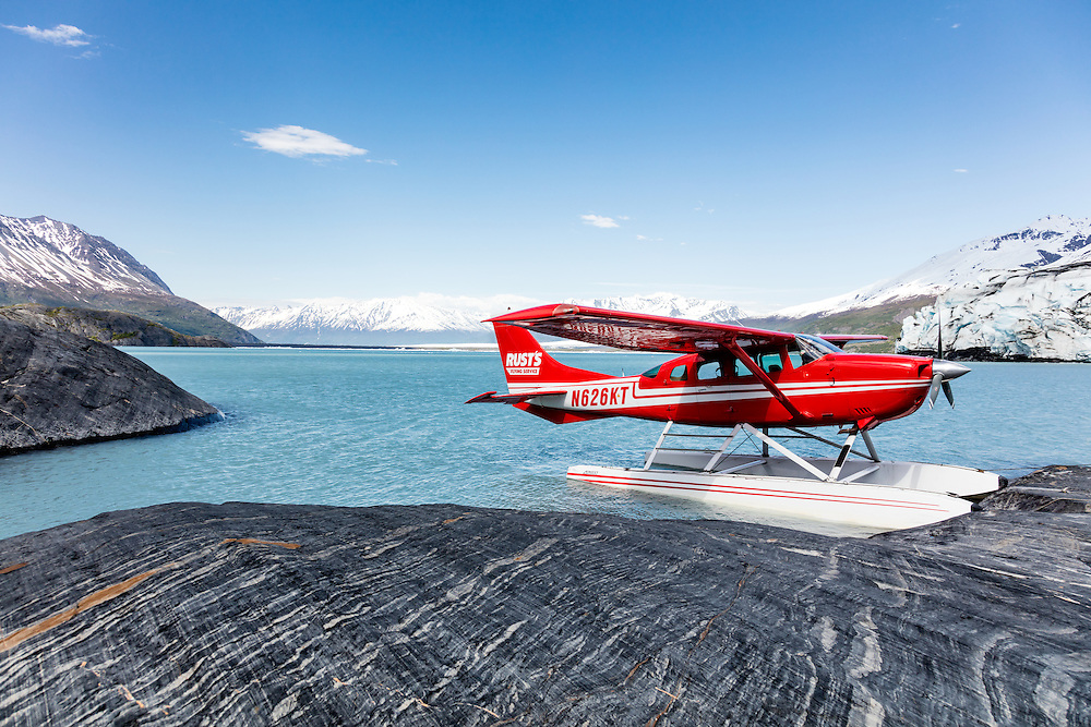 Float plane parked along Colony Glacier and Inner Lake George in Chugach National Forest in Southcentral Alaska. Spring. Afternoon.