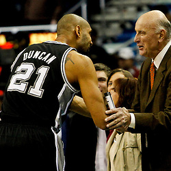 Jan 7, 2013; New Orleans, LA, USA; San Antonio Spurs power forward Tim Duncan (21) talks with former NBA player Bob Pettit before the start of a game against the New Orleans Hornets at the New Orleans Arena. Mandatory Credit: Derick E. Hingle-USA TODAY Sports