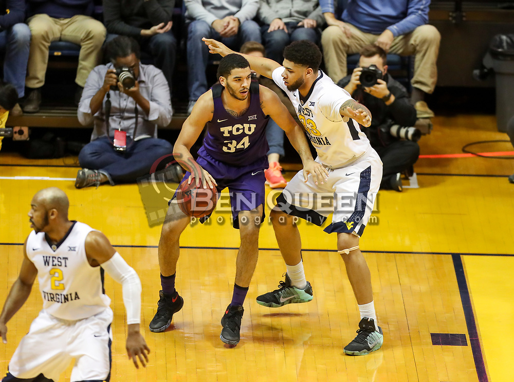 Feb 12, 2018; Morgantown, WV, USA; TCU Horned Frogs guard Kenrich Williams (34) backs down West Virginia Mountaineers forward Esa Ahmad (23) during the first half at WVU Coliseum. Mandatory Credit: Ben Queen-USA TODAY Sports