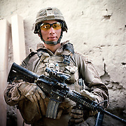 Location:<br /> Patrol Base Fires, Sangin District, Helmand Province, Afghanistan<br /> <br /> Unit: <br /> 3rd Squad, 1st Platoon, Bravo Company, 1st Battalion, 5th Marines<br /> <br /> Name and Rank: Lance Corporal Jeffrey Lopez<br /> <br /> Age: 22<br /> <br /> Hometown: Ventnor City, New Jersey<br /> <br /> Interview selections:<br /> <br /> Why did you join the Marines?<br /> <br /> &quot;I joined the Marine Corps because one of my boys died in Iraq. He was in the Army, and I had three other boys, they were in the Marine Corps. And I saw that they deployed too, and they all made it back alive. So I figured I would go Marine Corps.&quot;<br /> <br /> Describe Sangin:<br /> <br /> &quot;Sangin's crazy. I mean it looks nice, as far as its features, like trees and all that, it looks like a beautiful country. But as far as steppin' outside the wire with all your gear, it's shitty . . . I can't really explain it. It's somewhere you don't wanna be.&quot;<br /> <br /> Why do you think the Taliban are fighting?<br /> <br /> &quot;I think the Taliban's out here doing what they do because they don't want us controlling what they do . . . it's just like your parents telling you, 'Hey do this.' Like, they don't like authority, I guess. So we come here, 'Hey this is how you're gonna live your life,' and it's like, &quot;No, we're gonna fucking still be the rebels we are, not caring about other peoples' lives, still trying to get these drugs out.'&quot;<br /> <br /> How do you rate them as a fighting force?<br /> <br /> &quot;They fight like fake ass gangs back in the States. If they're not in a big group or whatever, if they can't get that upper hand, they're not even gonna try to face you. They're just gonna fall back . . . I mean if they were to step up and try to fight us like we fight them, they wouldn't stand a chance.&quot;<br /> <br /> &quot;Like planting IEDs, shooting as us from where we can't see them, hiding behind stuff.&quot;<br /> <br /> What's your job in the squad?<br /> <br /> &quot;Lately I&rsquo;ve been sweeping, that&rsquo;s been my job. And when we first got here it wasn&rsquo;t as bad, but now that the IED threat is getting a lot heavier, it&rsquo;s kind of starting to suck, each day going out, like 'Damn I gotta sweep again.'