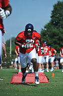 Ole Miss' Aaron Morris (72) goes through a drill as Ole Miss began football practice in Oxford, Miss. on Saturday, August 4, 2012.