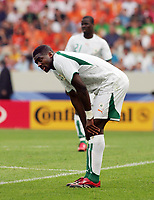 Photo: Chris Ratcliffe.<br /> Holland v Ivory Coast. Group C, FIFA World Cup 2006. 16/06/2006.<br /> Kolo Toure and Emmanuel Eboue (background) of Ivory Coast are gutted as they go out.
