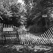 Collapsing perimeter fence, Glastonbury, Somerset, 1989