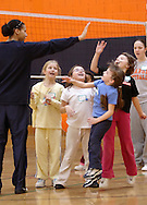 Middletown, N.Y. - Two 7-year-old girls leap to give a high five to one of their team's leaders at the volleyball station during National Women in Sports Day on Feb. 11, 2006. Orange County Community College's Department of Movement Science celebrated the 20th Anniversary of National Girls and Women in Sports Day by holding an event for young girls that included volleyball, basketball, soccer, games and swimming. ©Tom Bushey