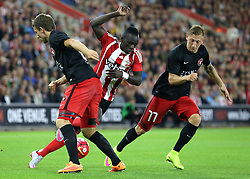 Sadio Mane of Southampton is challenged by Jesper Lauridsen and Daniel Royer of FC Midtjylland - Mandatory byline: Paul Terry/JMP - 07966386802 - 20/08/2015 - FOOTBALL - ST Marys Stadium -Southampton,England - Southampton v FC Midtjylland - EUROPA League Play-Off Round