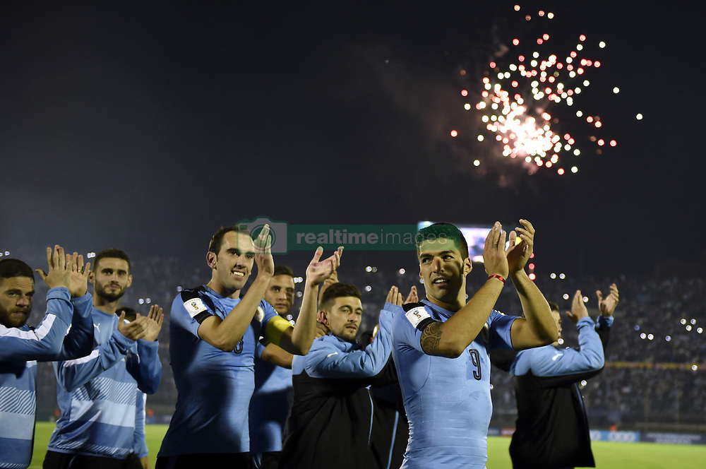 (171011) -- MONTEVIDEO, Oct. 11, 2017 (Xinhua) -- Uruguay's players celebrate after the Russia 2018 FIFA World Cup qualifier match against Bolivia, at Centenario stadium, in Montevideo, Uruguay, on Oct. 10, 2017. Uruguay won 4-2. (Xinhua/Nicolas Celaya) (ma) (da).