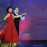 "BEIJING, 18 DECEMBER 2004: Liu Yulan,62, the oldest participant at the ""first worldwide artificial beauty pageant ""  shows her ballroom dancing skills in a theatre in Beijing, 18 December , 2003, in China...Beauty business in China , from cosmetic surgeries to hair brush sales, has amounted to more than USD 7 billion in 2003. The contest for women who have undetgone plastic surgery was organized after Yang Yuan, a young would-be model, was disqualified earlier on this year when organizers discovered that she'd had plastic surgery. Yang was present during the contest to introduce her biography that explains why she has the right to ""improve"" her natural features..."