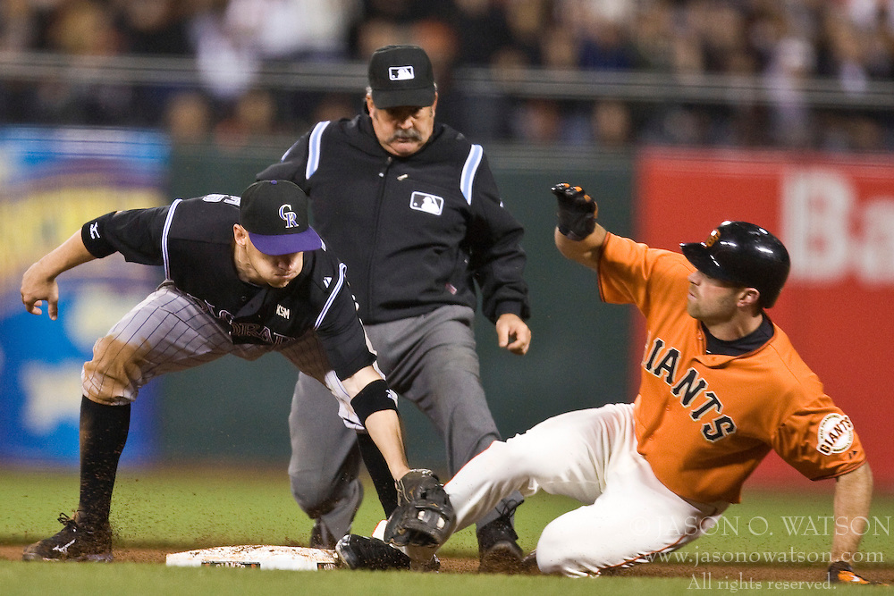 April 30, 2010; San Francisco, CA, USA;  San Francisco Giants right fielder Nate Schierholtz (12) beats a tag from Colorado Rockies second baseman Clint Barmes (12) on a double during the sixth inning at AT&T Park.  San Francisco defeated Colorado 5-2.