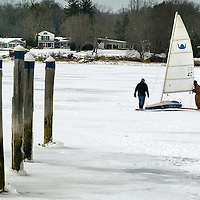 """(PSTORE) Red Bank 1/28/2004  A lonely iceboat gets pushed back to the """"pits"""" as ice conditions hampered sailing on the Navesink River.  Snow that became a crusty slows down the boats.    Michael J. Treola Staff Photographer"""