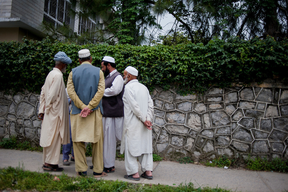 A group of men talk in a group on a sidewalk of a residential district of Abbottabad, Khyber Pakhtunkhwa province, Pakistan on May 5, 2011. US special forces launched an agressive attack on the compound early morning on May 2 killing Osama bin Laden.
