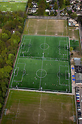 Nederland, Noord-Holland, Bussum, 28-04-2010; schoolkinderen sporten en krijgen gym op kunstgras sportveld..School sports and gymnastics on artificial turf..luchtfoto (toeslag), aerial photo (additional fee required).foto/photo Siebe Swart