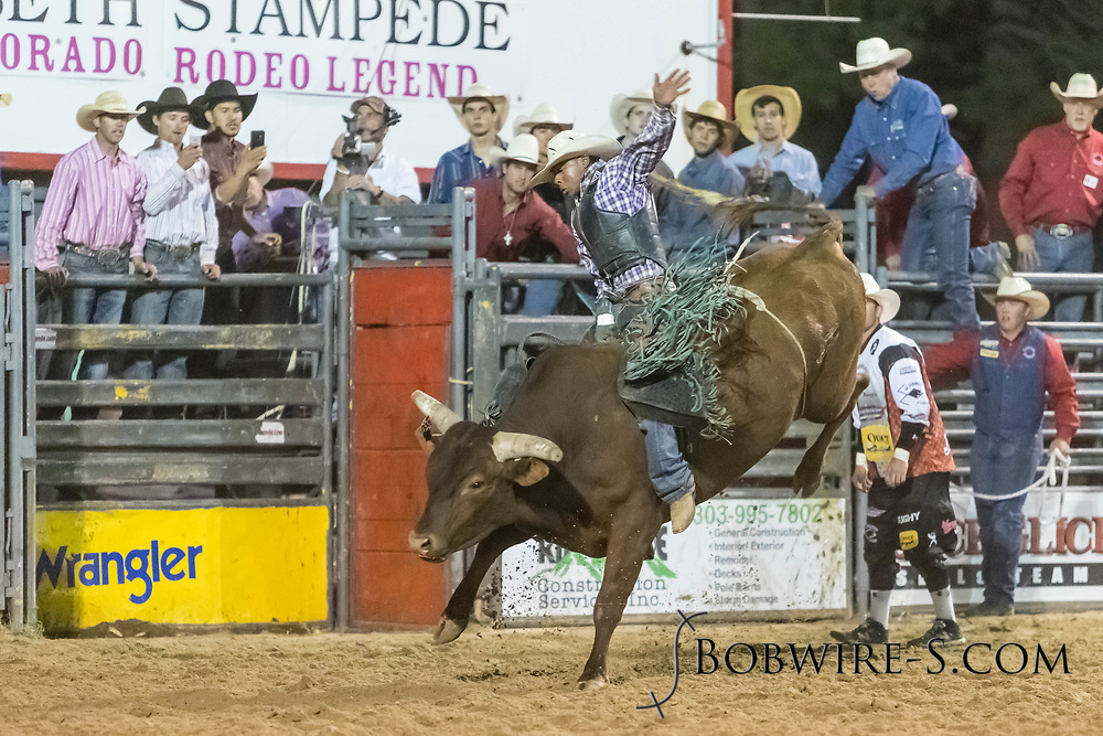 Bull rider Laramie Mosley rides Summit Pro Rodeo's Panama Red in the second performance of the Elizabeth Stampede on Saturday, June 2, 2018.
