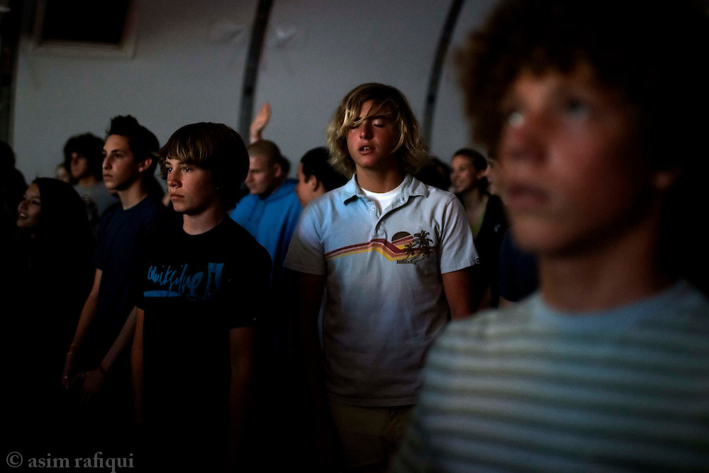 At a service for high school adoloescents - children from schools around the region come together for weekly services designed to satisfy their tastes and preferences<br />