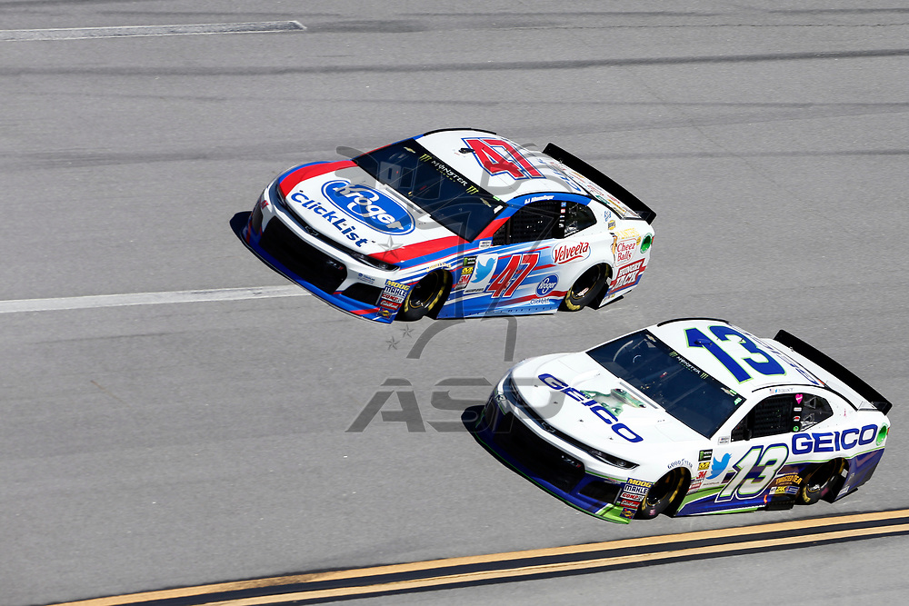 Ty Dillon (13) brings his car through the turn 4 during practice for the 1000Bulbs.com 500 at Talladega Superspeedway in Talladega, Alabama.