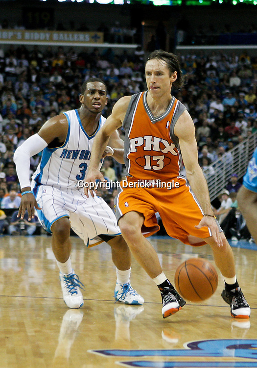 08 April 2009: Phoenix Suns guard Steve Nash (13) drives by New Orleans Hornets guard Chris Paul (3) during a 105-100 loss by the New Orleans Hornets to the Phoenix Suns at the New Orleans Arena in New Orleans, Louisiana.