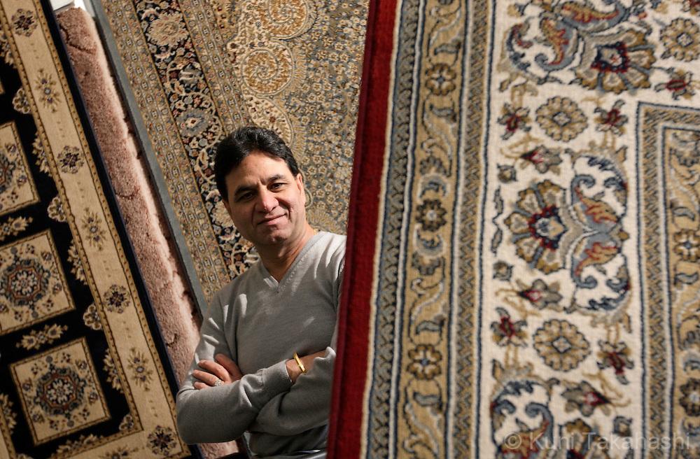 Balvinder Singh poses at his carpets shop in Chicago on Dec 21, 2008.