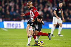 Daniel James of Manchester United takes on David McGoldrick of Sheffield United - Mandatory by-line: Robbie Stephenson/JMP - 24/11/2019 - FOOTBALL - Bramall Lane - Sheffield, England - Sheffield United v Manchester United - Premier League