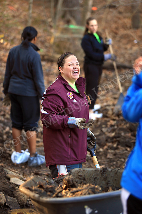 Jalisa Gorby, of Coldwater, shares a laugh as she helps clear a stream bed. She was among nine CMU students who travelled to the YMCA of Western NC Youth Service Center to spend the week to help with projects to improve the center and in the community. They addressed access to sports and recreation and built a kiosk, cleared a stream bed and worked with elementary students in an after school program as their Alternative Break project. CMU is ranked fourth in the nation for the number of students participating in Alternative Breaks and fifth in the country for the most trips coordinated by a university. The program organizes about 40 trips each year with more than 400 students participating. Photo by Steve Jessmore/Central Michigan University