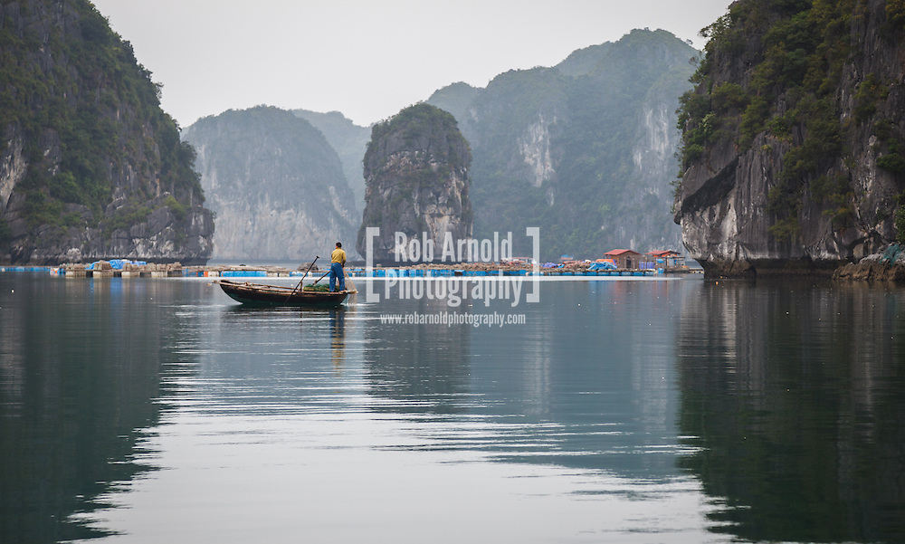 22/04/2013, Lan Ha Bay, Vietnam. A man fishing surrounded by the Limestone Karst formations in Lan Ha Bay, Vietnam. Photo by Rob Arnold