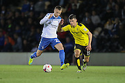 Burton Albion midfielder Callum Reilly (17) and Bury FC defender Niall Maher (22) challenge for the ball during the EFL Cup match between Burton Albion and Bury at the Pirelli Stadium, Burton upon Trent, England on 10 August 2016. Photo by Aaron  Lupton.
