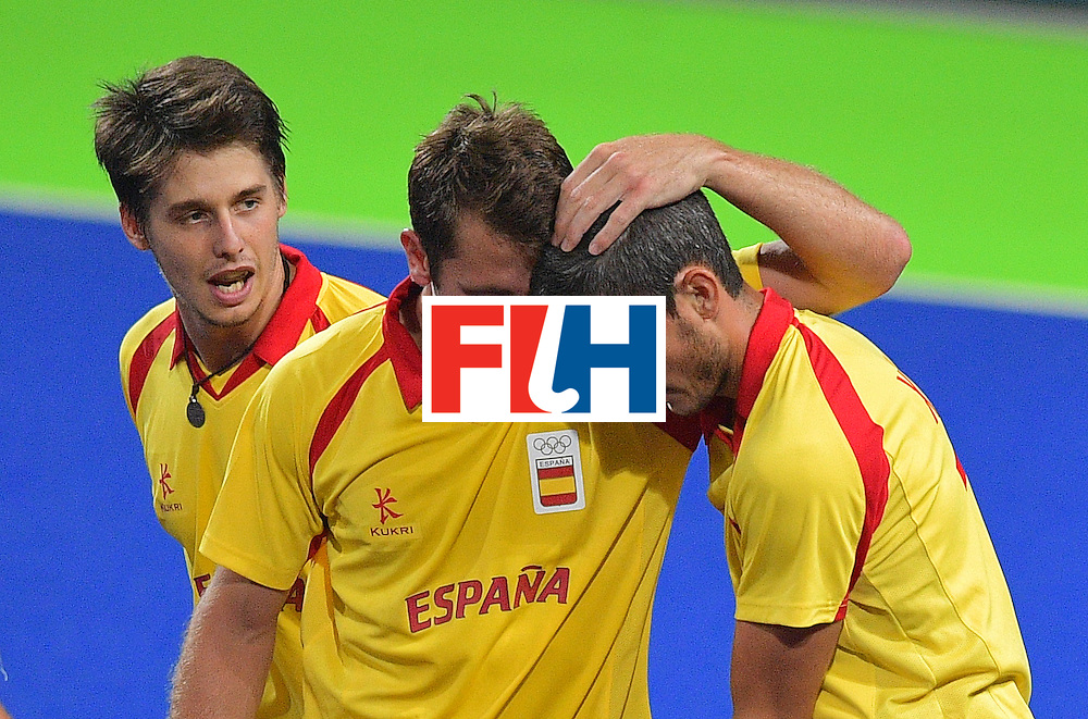 Spain's Xavi Lleonart (R) celebrates scoring a goal with teammates Roc Oliva (C) and  Josep Romeu during the men's field hockey Spain vs Brazil match of the Rio 2016 Olympics Games at the Olympic Hockey Centre in Rio de Janeiro on August, 6 2016. / AFP / Carl DE SOUZA        (Photo credit should read CARL DE SOUZA/AFP/Getty Images)