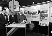 10/01/1986.01/10/1986.10th January 1986.The Aer Lingus Young Scientist of the Year Exhibition at the RDS, Dublin...J.M Beveridge, (centre) Managing Director of Irish Shell Ltd., with Aidan Rowsome, (left) of U.C.D and Noel Tierney, Irish Shell at the Irish Shell Education Service for Schools stand at the Exhibition..