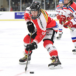 COBOURG, - Dec 18, 2015 -  WJAC Game 11- Team Czech Republic vs Team Switzerland at the 2015 World Junior A Challenge at the Cobourg Community Centre, ON. Yannick Lerch #18 of Team Switzerland skates with the puck during the first period.<br /> (Photo: Andy Corneau / OJHL Images)
