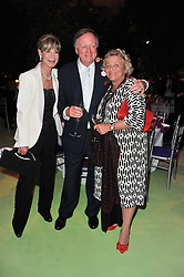 Left to right, ROSEMARY SAID, ANDREW PARKER-BOWLES and DAME VIVIEN DUFFIELD at a dinner hosted by Cartier in celebration of the Chelsea Flower Show held at Battersea Power Station, 188 Kirtling Street, London SW8 on 23rd May 2011.