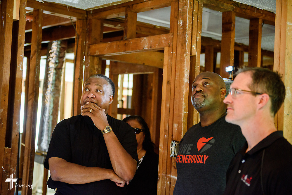 The Rev. Dr Roosevelt Gray, Jr., director of LCMS Black Ministry, and the Rev. Dr. Steve Schave, director of LCMS Urban & Inner City Mission and director of LCMS Church Planting, survey a home damaged by Hurricane Harvey on Tuesday, Sept. 26, 2017, in Houston. LCMS Communications/Erik M. Lunsford