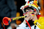 A German fan blows a Vuvuzela during the 2010 FIFA World Cup South Africa Group D match between Ghana and Germany at Soccer City Stadium on June 23, 2010 in Johannesburg, South Africa.