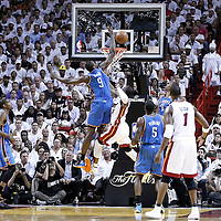 19 June 2012: Miami Heat shooting guard Dwyane Wade (3) is fouled by Oklahoma City Thunder power forward Serge Ibaka (9) during the first quarter of Game 4 of the 2012 NBA Finals, Thunder at Heat, at the AmericanAirlinesArena, Miami, Florida, USA.