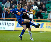 Photo: Ed Godden.<br />Barnet v Stockport County. Coca Cola League 2. 29/04/2006. Jamie Ward (L) collides with Barnet's Adam Gross.