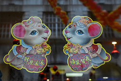 © Licensed to London News Pictures. 24/01/2020. LONDON, UK.  A window is decorated with cute Year of the Rat designs as red lanterns hang above Chinatown ahead of Chinese New Year, the Year of the Rat.   Photo credit: Stephen Chung/LNP