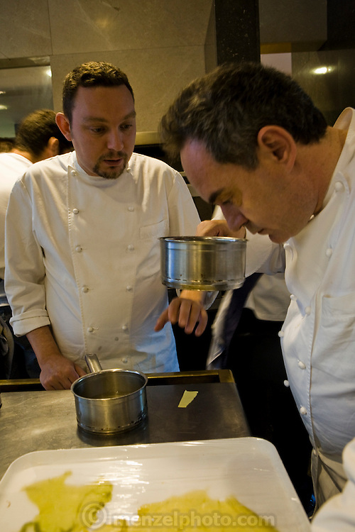 Ferran Adrià (right), chef of El Bulli restaurant near Rosas on the Costa Brava,  in northern Spain, smells ingredients while speaking to a colleague. (Ferran Adria is featured in the book What I Eat: Around the World in 80 Diets.)