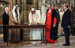 The President of the United Arab Emirates, Sheikh Khalifa bin Zayed Al Nahyan signs the distinguished visitors book  in Westminster Abbey, London,  on the second day of his state visit to the UK,  Wednesday 1st May 2013.  Photo by: Stephen Lock / i-Images