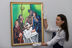 "© Licensed to London News Pictures. 16/11/2018. LONDON, UK. A technician presents ""The Joke"", 1923, by William Roberts (Est. GBP300,000-500,000). Preview of Sotheby's autumn sale of Modern & Post War British art.  Works from the British art scene of the past century will be offered for sale on 20 and 21 November 2018 at Sotheby's in London.  Photo credit: Stephen Chung/LNP"