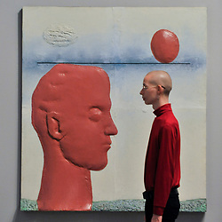 "© Licensed to London News Pictures. 17/10/2017. London, UK. A staff member views ""Head with a Balloon"", 1965, at a preview of ""Not Everyone Will Be Taken Into The Future"", the first UK exhibition by Russian artists Ilya and Emilia Kabakov.  The exhibition coincides with the 100th anniversary of the 1917 Russian Revolution and shows the couple's large scale installations and conceptual art.  Held at Tate Modern, the show runs 18 October to 28 January 2018. Photo credit : Stephen Chung/LNP"