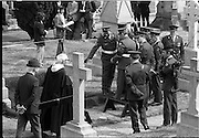 Funeral of Eamon DeValera.   (J72)..1975..02.09.1975..09.02.1975..2nd September 1975..Today saw the funeral of Eamon DeValera. He was laid to rest beside his wife Sinead in Glasnevin Cemetery,Dublin. Dignitries from all around the world attended at the funeral...Image of a group of military personnel inspecting the gravesite of Eamon DeValera.
