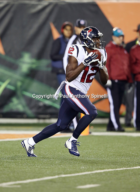 Houston Texans wide receiver Keith Mumphery (12) returns a punt during the 2015 week 10 regular season NFL football game against the Cincinnati Bengals on Monday, Nov. 16, 2015 in Cincinnati. The Texans won the game 10-6. (©Paul Anthony Spinelli)