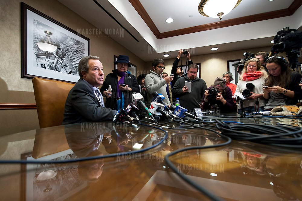 January 21, 2014 - New York, NY : <br /> David H. Perecman, attorney for the family of Avonte Oquendo, held a press conference at his office at 250 West 57th Street in Manhattan on Tuesday afternoon to announce that the remains <br /> discovered along the East River in Queens last week were matched to the missing autistic teenager. Pictured here, Mr. Perecman, seated at far left, speaks with reporters.<br /> CREDIT: Karsten Moran for The New York Times