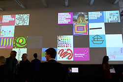 Tate and Bloomberg launch New Creative Space. <br /> Tate's ambitious digital strategy was highlighted today at the launch of a pioneering new project called Bloomberg Connects. This will enable members of the public to show their own interpretation of the art at Tate Modern. Seventy-five screens in total, over half cascading in a spine on the walls throughout the building, will display visitors ideas and comments. A digital drawing bar will allow people to respond visually to their visit and see large-scale versions of their art works projected on the wall. Tate collection will be used to stimulate a conversation between Tate and its visitors by using the Bloomberg-supported digital space as a fresh canvas for creativity. Artists Michael Craig-Martin and Gayle Chong Kwan were present with Tate Director Nicholas Serota at Launch of this major in-gallery project at Tate Modern, London, United Kingdom. Thursday, 19th September 2013. Picture by Nils Jorgensen / i-Images