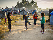 04 MARCH 2017 - KATHMANDU, NEPAL: Girls play a hopscotch type game in an IDP camp in the center of Kathmandu. The camp opened days after the April 2015 earthquake devastated Nepal, killing almost 9,000 people. At its peak, about 1,800 families lived in the camp. The camp is still open nearly two years after the earthquake, about 400 families currently live in the camp. Camp residents say the Kathmandu municipal government is trying to close the camp and is encouraging residents to find new housing. They said the government is cutting off services to the camp and last week stopped the free distribution of water, although water can be purchased for delivery. Most of the people in the camp came to Kathmandu from rural villages in the mountains in the weeks after the earthquake. Many of the residents of the camp, technically homeless, have found work in Kathmandu's bustling construction industry, rebuilding homes destroyed in the earthquake.       PHOTO BY JACK KURTZ